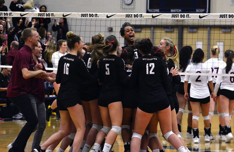 TIMES PHOTO: MATT SINGLEDECKER - Southridge senior Natalie Hoff and the Skyhawks celebrate their first volleyball state championship in school history.