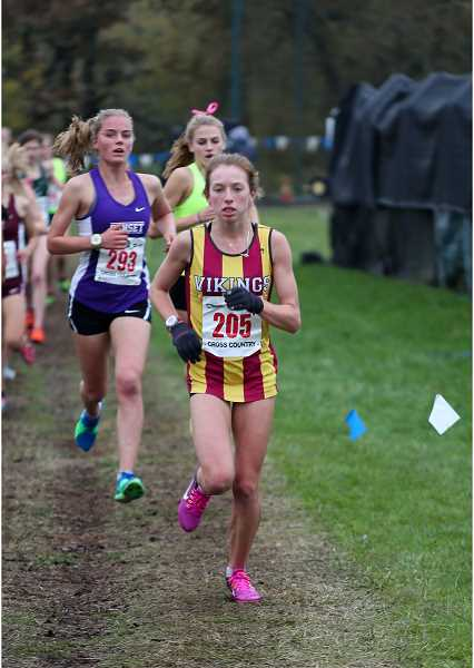 PMG PHOTO - Forest Grove's Hannah Berdahl runs during the state cross country meet Nov. 4 at Lane Community College in Eugene.