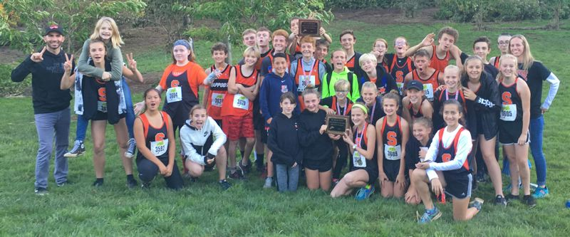 PHOTO COURTESY: DARREN HANKE - Scappoose's boys and girls celebrate their Northwest Middle School District Meet team championships Oct. 24 at Hydrangea Ranch in Tillamook.