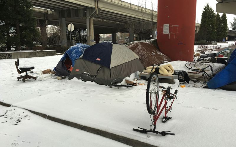 PAMPLIN MEDIA GROUP FILE PHOTO - Many homeless people decide to stay outside even during severe weather.