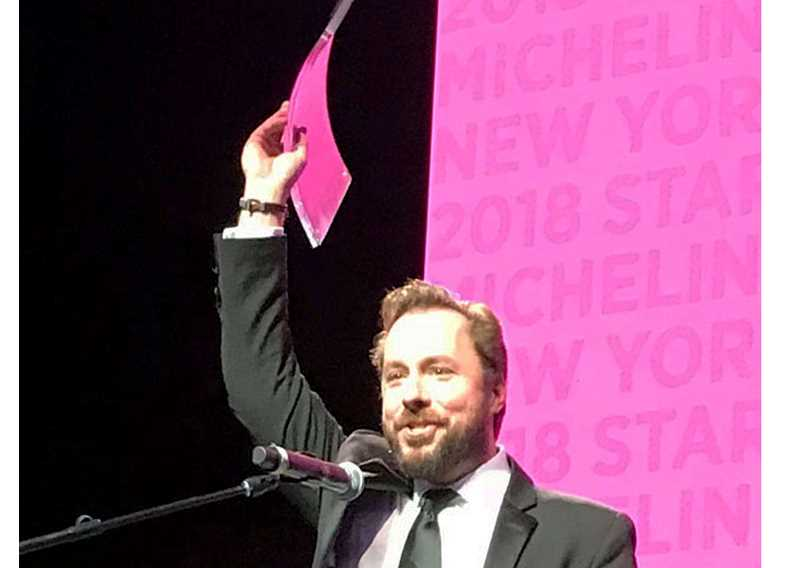 SUBMITTED PHOTO - A to Z Wineworks co-founder Sam Tannahill accepts the Wine Advocate Extraordinary Winery 'Under the Gun' award at a ceremony held Oct. 30 in New York City.