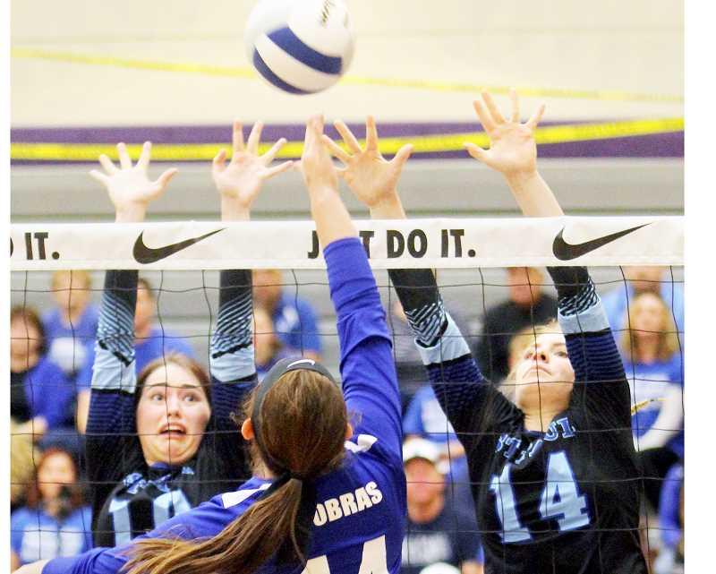 SETH GORDON - Haley Scott and Isabelle Wyss defend the net during St. Paul's 3-1 loss to Central Linn in the 2A state quarterfinals Friday. The Bucks rebounded to beat Heppner and Monroe to claim fourth place, their highest showing in four years at the 2A level.