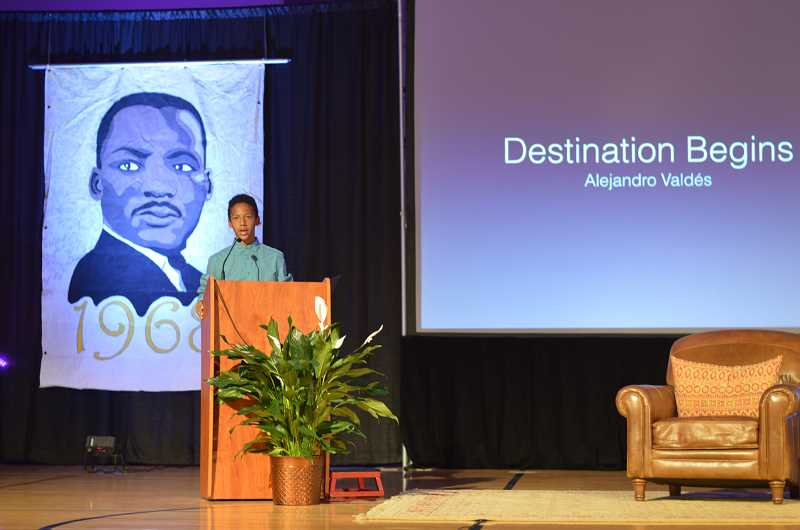 TIDINGS PHOTO: CLARA HOWELL - Eighth-grader Alejandro Valdes shares a speech during the global justice assembly.