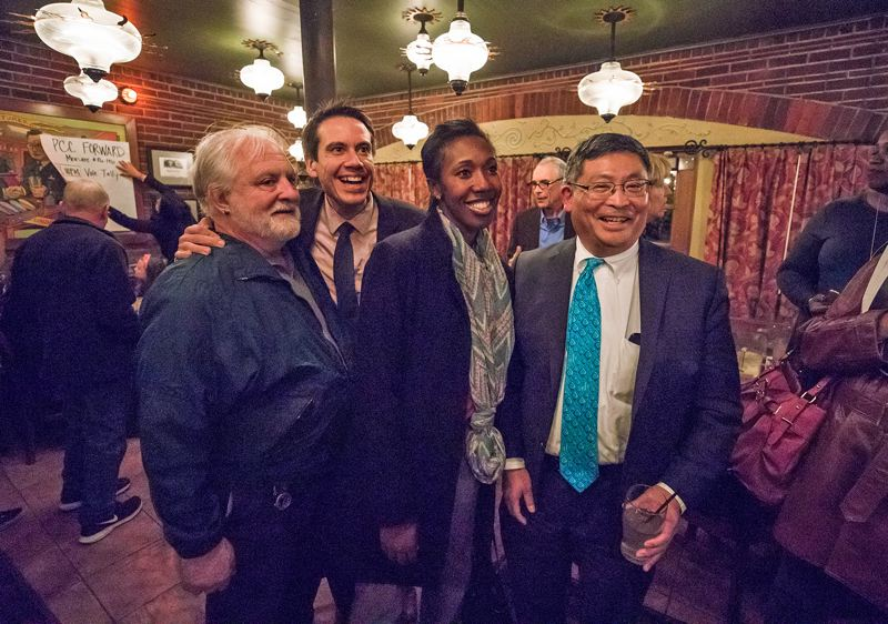 TIMES PHOTO: JONATHAN HOUSE - PCC President Mark Mitsui, right, and board members (from left) Michael Sonnleitner, Valdez Bravo and board chair Kali Thorne Ladd pose for pictures after the first ballot returns for this year's bond measure.