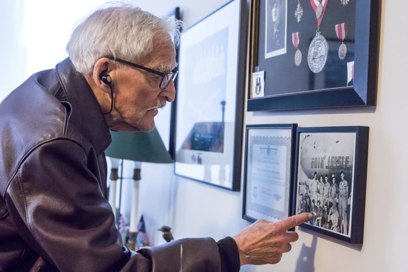 PORTLAND TRIBUNE: JONATHAN HOUSE - Jack Cramer points out his fellow B-29 crew members in a photo hanging on the wall of the den in his downtown Portland apartment, which also includes the medal he won for the missions they flew over Japan.
