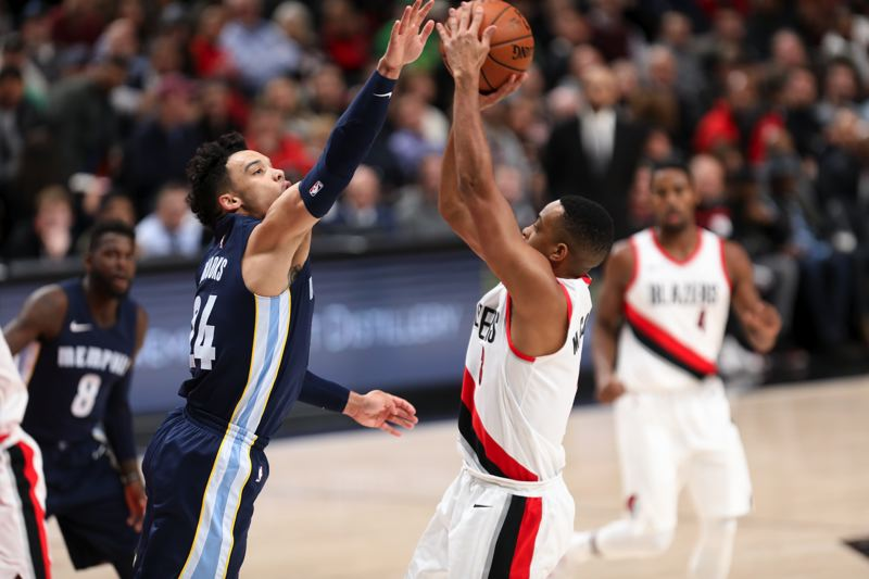 TRIBUNE PHOTO: DAVID BLAIR - Dillon Brooks of Memphis challenges a shot by the Blazers' CJ McCollum.