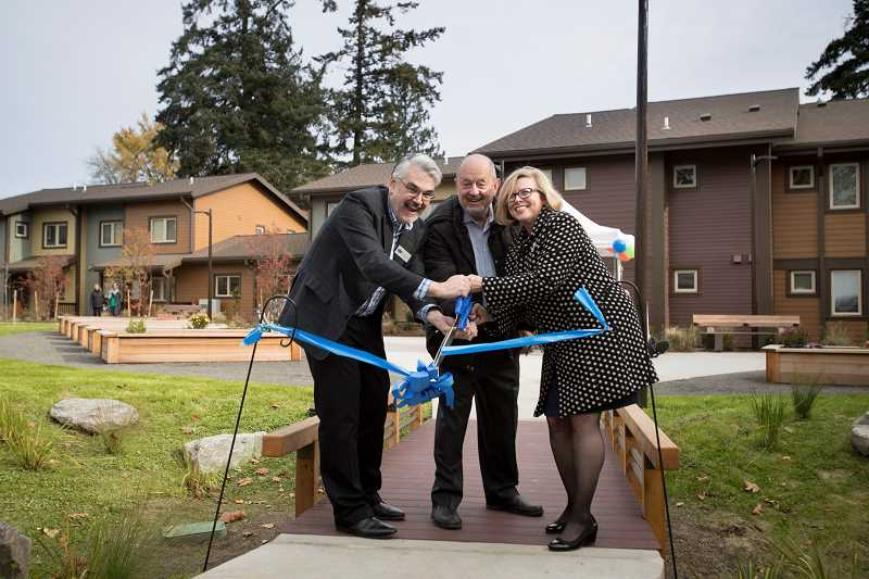 TIMES PHOTO: JAIME VALDEZ - Michael Schrader, Bridge Meadows Chair of Board of Directors, Beaverton City Mayor Denny Doyle and Dr. Derenda Schubert, executive director of Bridge Meadows, cut the ribbon to commemorate the grand opening of the multi-generational housing community.