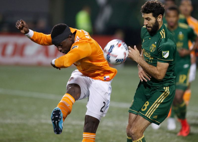 TRIBUNE PHOTO: JONATHAN HOUSE - Diego Valeri (right) pushes forward for the Portland Timbers in their Sunday season-ending home loss to the Houston Dynamo.