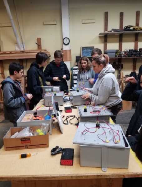 COURTESY: REBUILDING CENTER - Catilin Gabel students built solar-powered batteries for Portland's homeless population on Saturday, Oct. 21.