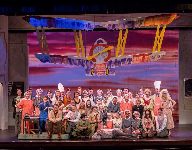 PHOTO COURTESY OF DAVID KINDER - Lake Oswego High's cast of 'The Drowsy Chaperone' poses in front of one of the most impressive parts of their set — an airplane that rises off the stage and carries students throughout the production.