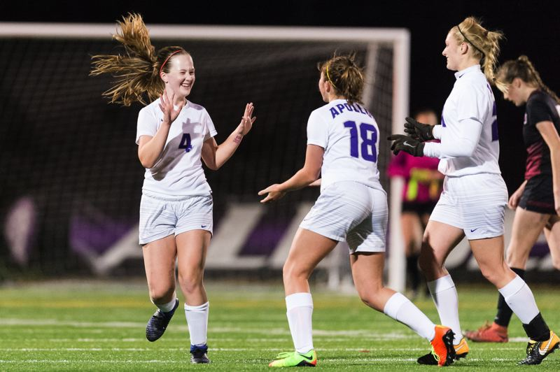 TIMES PHOTO: CHRIS OERTELL - Sunset defenders Keaton Lee and Betsy Brown celebrate a goal against Glencoe in the Class 6A semifinals.