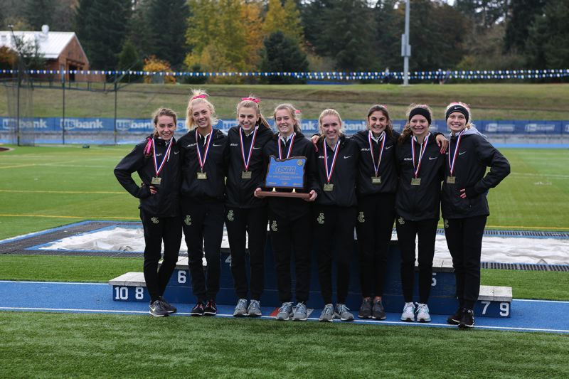 TIMES PHOTO: ADAM WICKHAM - The Jesuit girls cross country team won its second straight Class 6A state championship meet on Saturday.
