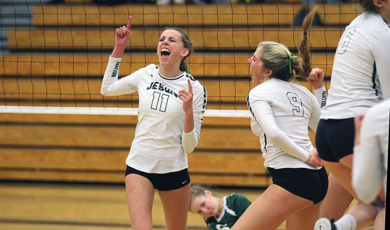 TIMES PHOTO: MATT SINGLEDECKER - Jesuit juniors Rose Booth and Lauren McCabe celebrate a point against West Linn at the 6A state tournament.