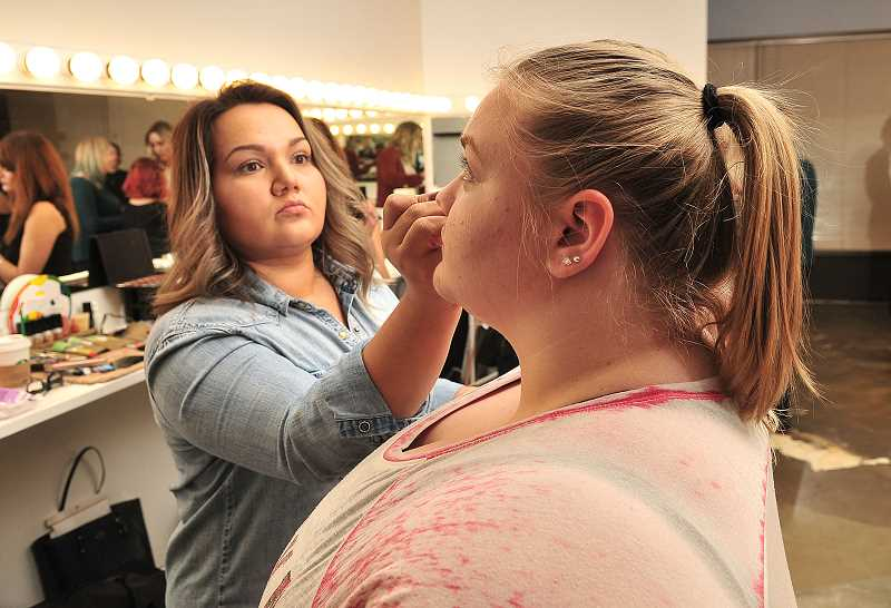 Kelly Trice applies makeup to AnneMarie Stelling in an Art of Makeup class.