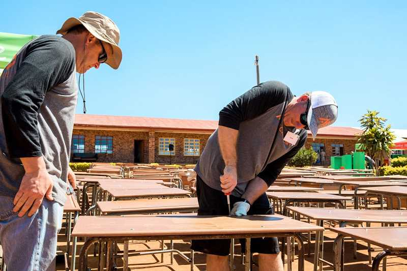 SUBMITTED PHOTOS - Academy Mortgage District Manager Scott Starr, pictured at left,  and 160 other Academy Mortgage employees were among the Service Expeditioners who traveled to South Africa to help improve Makwetse Schools infrastructure. Academy paid for the improvements.