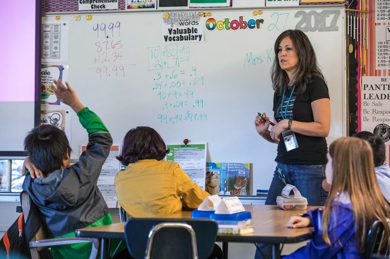 TRIBUNE PHOTO: JONATHAN HOUSE - Carla Montoya leads her Mill Park Elementary School class in a series of math problems.