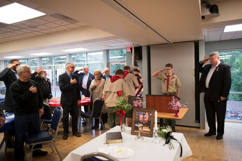 TIMES PHOTO: JAIME VALDEZ - A Boy Scout Troop 530 color guard presents the colors at the beginning of Thursday's veterans' recognition breakfast at the Juanita Pohl Center. In the foreground is the Missing Man Table, honoring military service members who were killed in action, went missing in action and taken as prisoners of war.