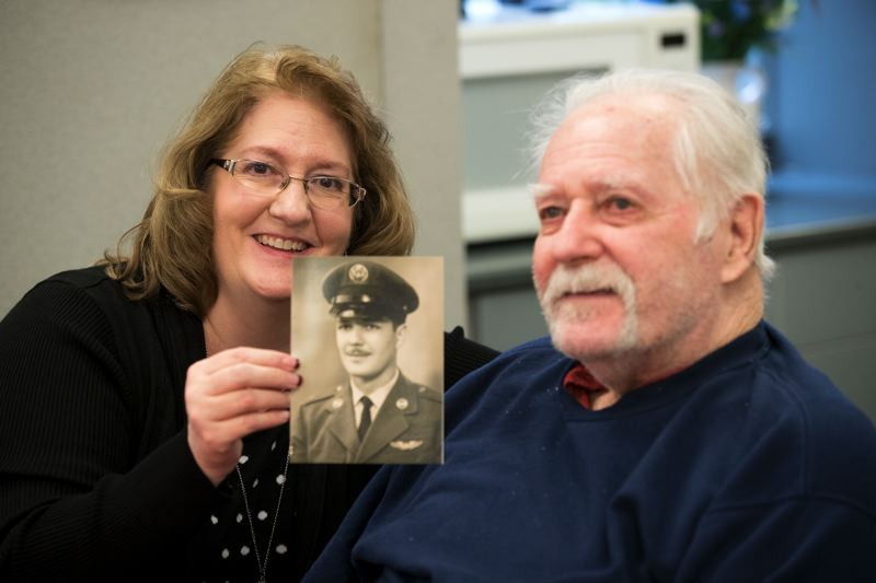 TIMES PHOTO: JAIME VALDEZ - Barb Werner holds up a picture of her father, Charles, next to him during breakfast at the Juanita Pohl Center.