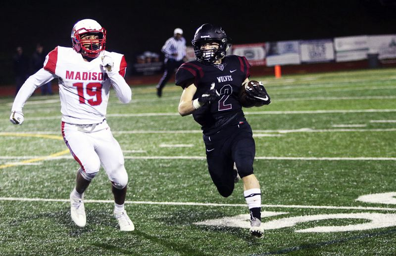 TIMES PHOTO: DAN BROOD - Tualatin junior running back Jake Anderson (right) and the Timberwolves will take their second shot of the season at Tigard tonight, aiming to upset the Tigers at Tigard High School at 7 p.m.