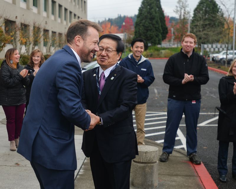 OUTLOOK PHOTO: JOSH KULLA - Gresham Mayor Shane Bemis greets Ebetsu, Japan, Mayor Noboru Miyoshi Monday morning at Gresham City Hall.