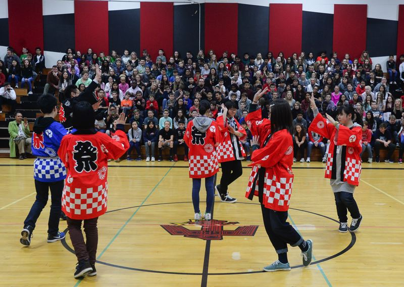 OUTLOOK PHOTO: JOSH KULLA - Exchange students from Ebetsu, Japan, perform a traditional Japanese dance for the student body at Russell Middle School Monday during a visit by a Sister City contingent from Ebetsu.