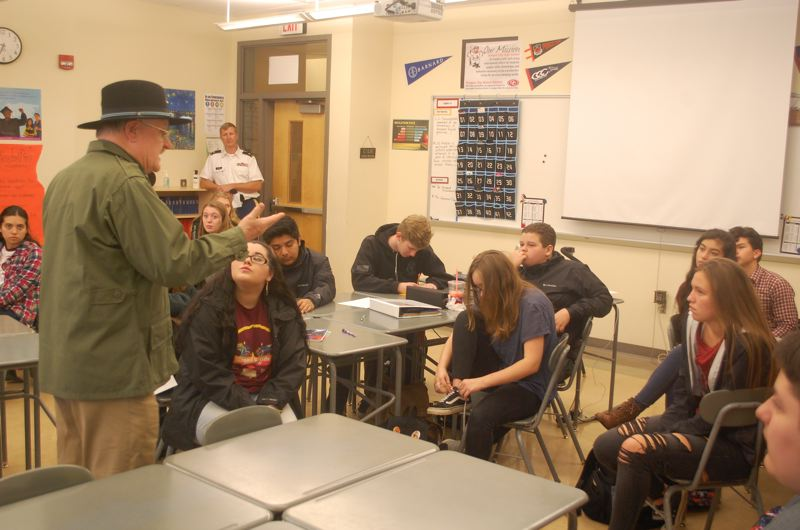 PHOTO BY: RAYMOND RENDLEMAN - Jim Jordan, who served in the 1st Cavalry Division during the Vietnam War, tells Oregon City High School students about his service.
