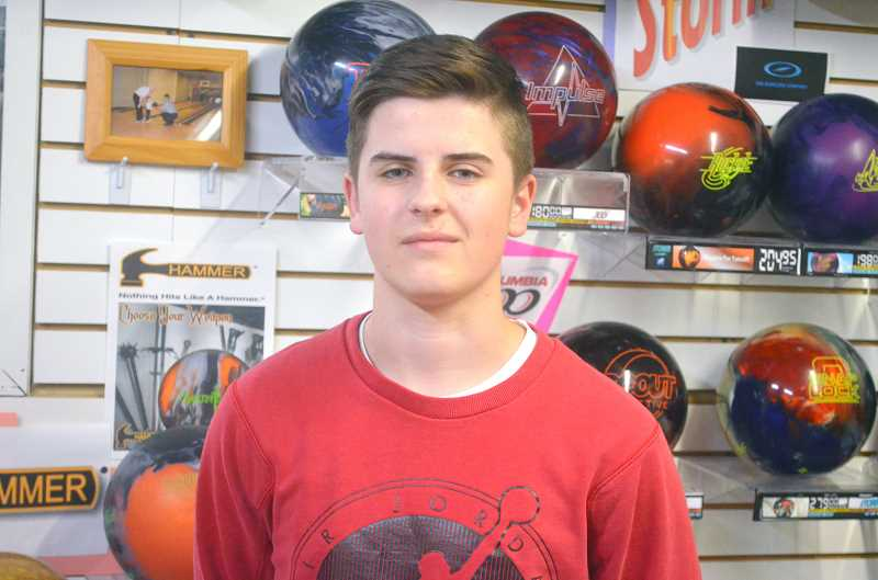SPOKESMAN PHOTO: TANNER RUSS - Trevor Johnson, 16, bowled a perfect game on Oct. 24. Johnson will compete on Wilsonville High Schools bowling team in the coming months. The team placed fourth in state last year.