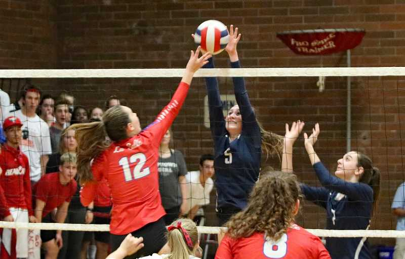 PAMPLIN MEDIA GROUP PHOTO: JIM BESEDA - Wilsonvilles Kennedy Juranek (5) goes to block a shot by La Salle Preps Katelyn Bell (12) during a Northwest Oregon Conference volleyball match at La Salle Prep. Juranek received an all league honorable mention.