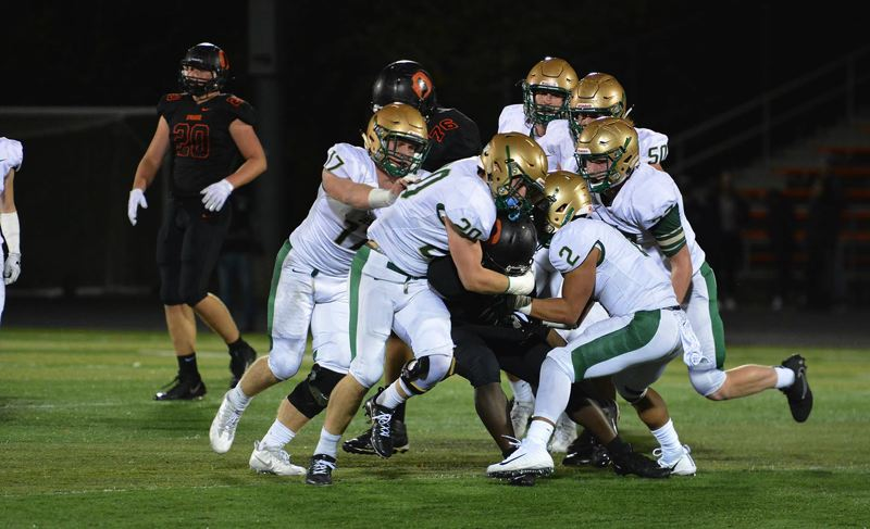 TIMES PHOTO: MATT SINGLEDECKER - The Jesuit defense was active and swarming against Sprague in the Class 6A playoffs on Friday.