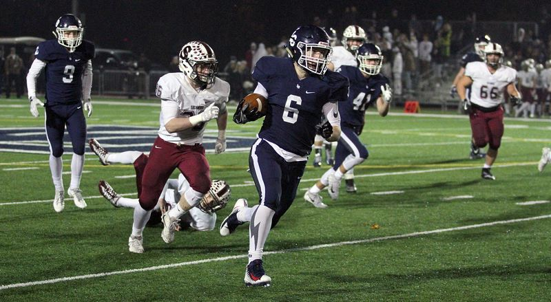 REVIEW PHOTO: MILES VANCE - Lake Oswego junior running back Collin Bracken runs to one of his three touchdowns during the Lakers' 45-0 home win over Sherwood in the second round of the Class 6A state playoffs on Friday.