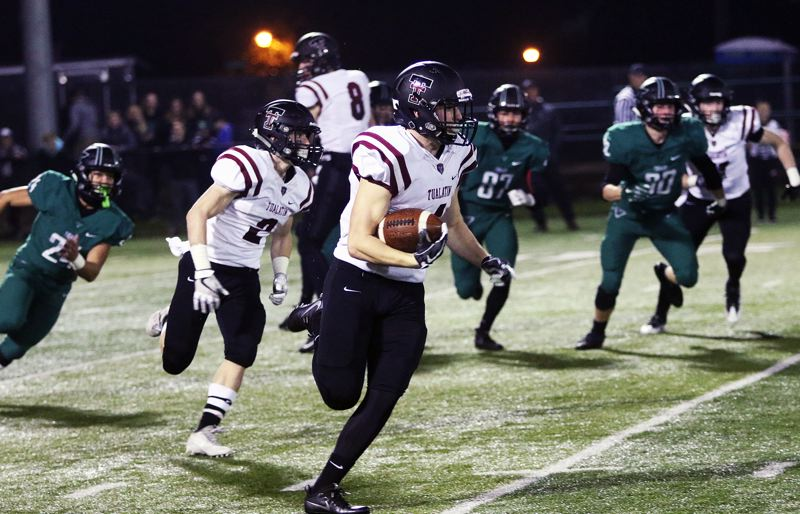 DAN BROOD - Tualatin senior Nathan Marx returns the opening kickoff 59 yards to help set up the first Timberwolf score of the game.
