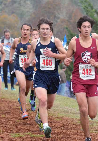 SPOKESMAN PHOTO: TANNER RUSS - Senior Jonathan Palmer ran with his team at the state meet in Eugene. Early in the season, Palmer established a PR of 16:23.4, and contributed to his teams overall success during the season.