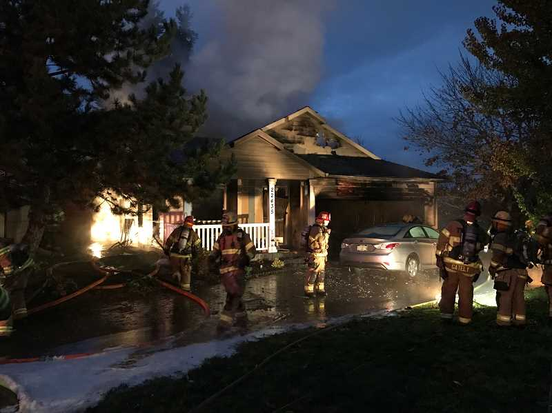 COURTESY OF TVF&R - Two dogs perished in an early-morning fire Saturday in Sherwood. No one else was injured but house is likely a total loss, fire officials say.