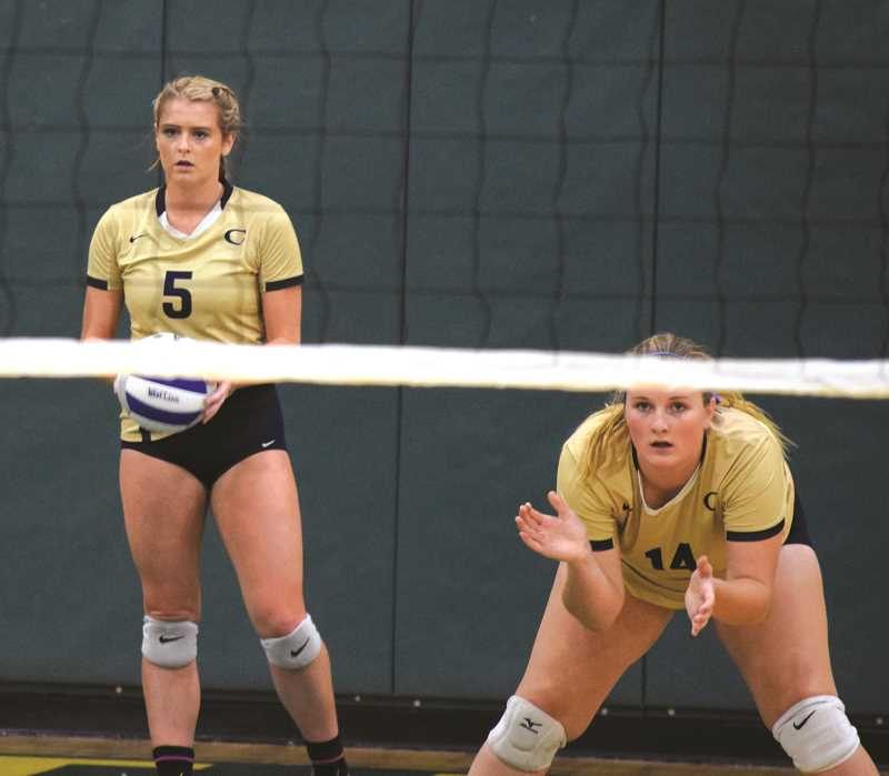 HERALD PHOTO: TANNER RUSS - Senior Sam Fossati was one of the leaders and powerful presences on the court, and sophomore Erika Evans was a vocal presence on the team. The Cougars finished their season 12-4 in league play, and 16-8 overall.