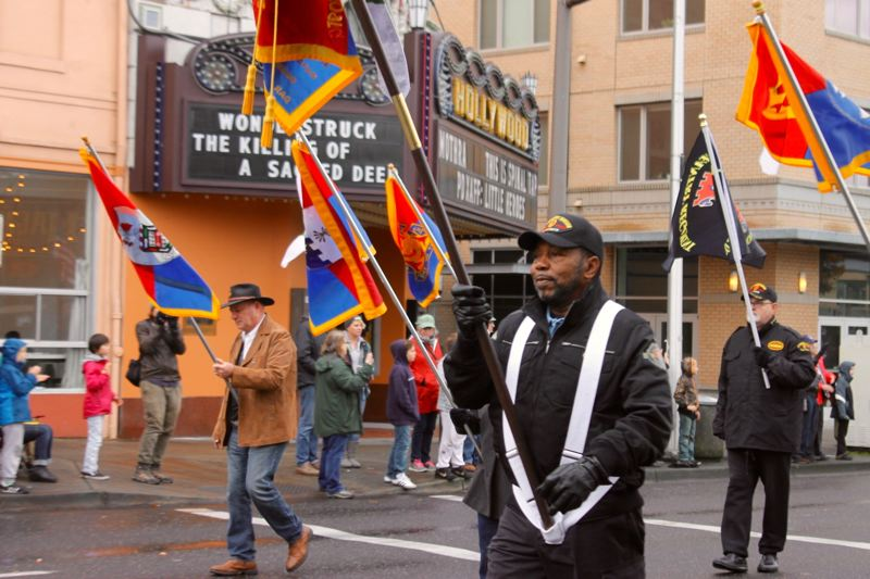 TRIBUNE PHOTO: LYNDSEY HEWITT - Hundreds observed Portland's 43rd annual Veterans Day Parade on Saturday.