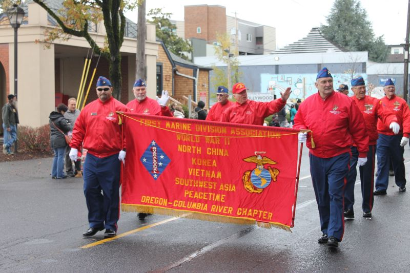 TRIBUNE PHOTO: LYNDSEY HEWITT - Veterans from several different groups and associations marched in the annual parade.