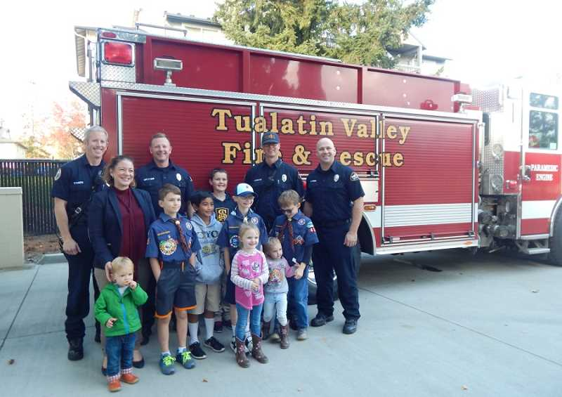 BARBARA SHERMAN - Jaimie Fender (second from left in rear), shown with TVF&R Station 35 Capt. Barry Quinn (third from left) and his crew, stands among Cub Scouts and others who threw a party to thank the firefighters for their hard work over the summer.