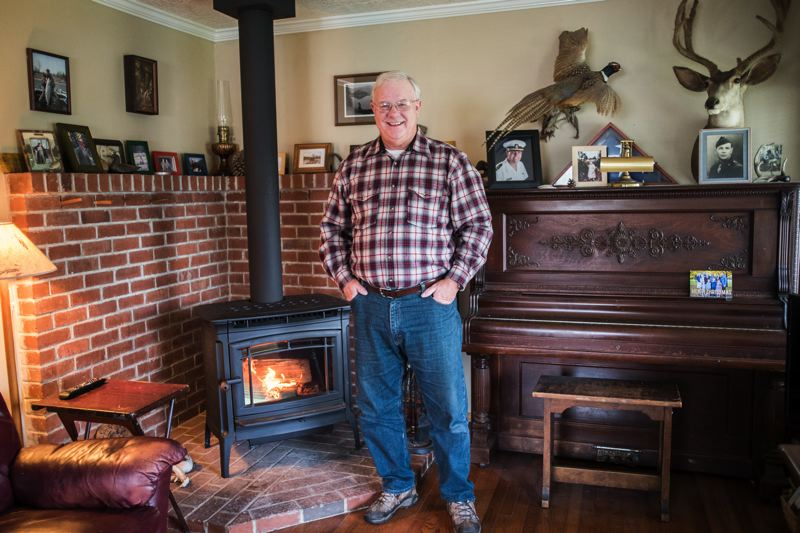 CHASE ALLGOOD; PAMPLIN MEDIA GROUP  - Raymond Dreyer of Beaverton replaced an old woodstove with a cleaner-burning new one, using subsidies granted by Washington County. 