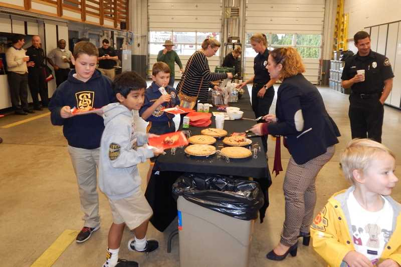 BARBARA SHERMAN - Everyone at the thank-you party for TVF&R firefighters at King City Station 35 enjoyed refreshments that included punch and snacks for the kids, pies provided by Shari's restaurant,and coffee and tea provided by Starbucks for the grown-ups.