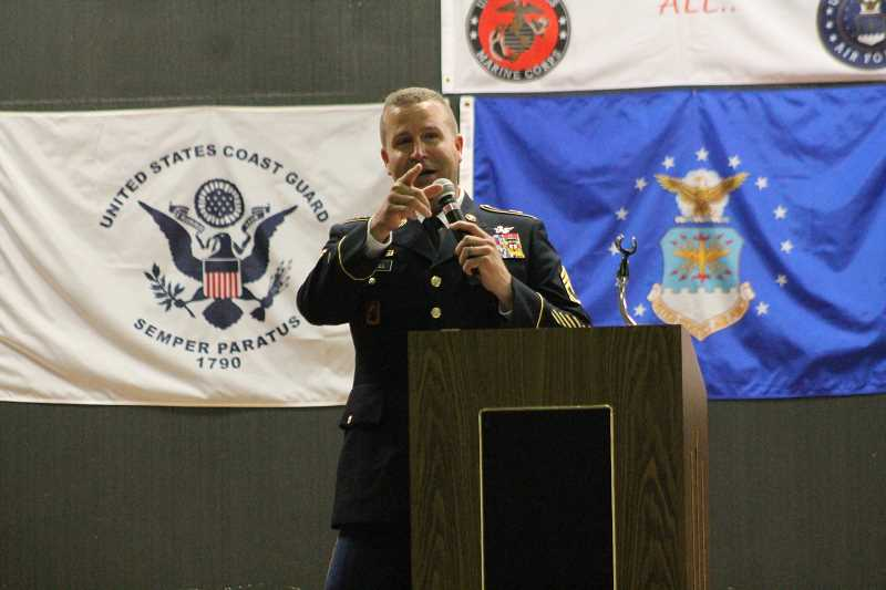PIONEER PHOTO: CONNER WILLIAMS - Travis Powell addresses the middle school students at the Veterans Day Program Nov. 8.