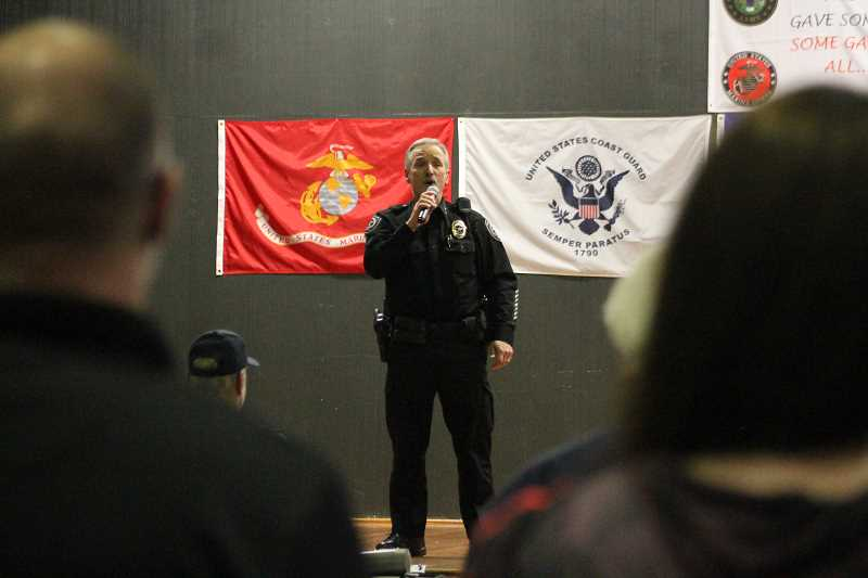 PIONEER PHOTO: CONNER WILLIAMS - Molalla Police Chief Rod Lucich sings a rendition of 'God Bless the USA' during the annual Veterans Day Program at MRMS on Nov. 8.
