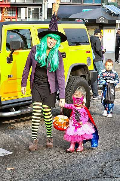DAVID F. ASHTON - Good witch Nicole Koffler marches along with a little princess, Ellie.