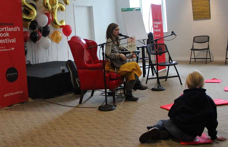 REVIEW PHOTO: COREY BUCHANAN - Emily Arrow sang songs about books at the begginning of Wordstock on Saturday.