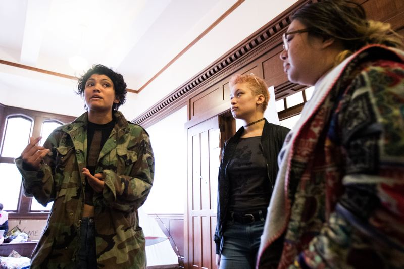 TRIBUNE PHOTO: JAIME VALDEZ - From left, Reed College students Addison Bates, Alex Boyd and Tiffany Chang talk about the divestment campaign that led to occupying President John Kroger's office since Oct. 23.
