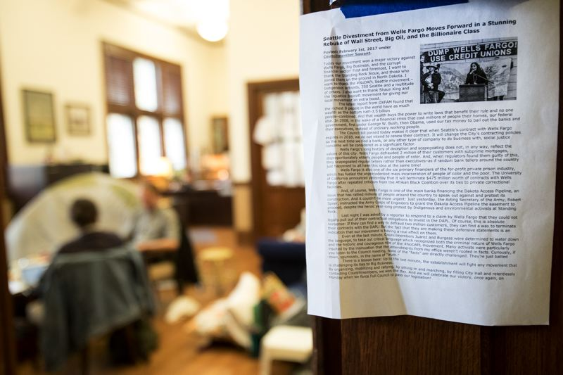 TRIBUNE PHOTO: JAIME VALDEZ - Protesters occupy Reed College President John Kroger's office, with signs posted throughout the building demanding divestment and pushing social justice issues.