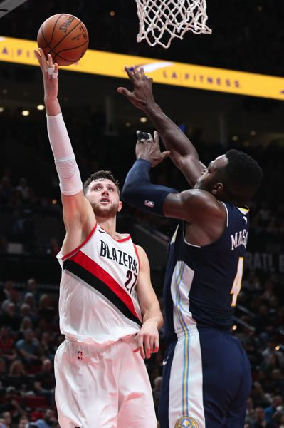 TRIBUNE PHOTO: JAIME VALDEZ - Trail Blazers center Jusuf Nurkic shoots over Paul Millsap of the Denver Nuggets.