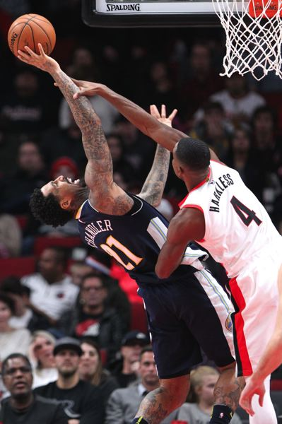 TRIBUNE PHOTO: JAIME VALDEZ - Moe Harkless (right) of the Blazers defends a shot by Denver's Wilson Chandler.