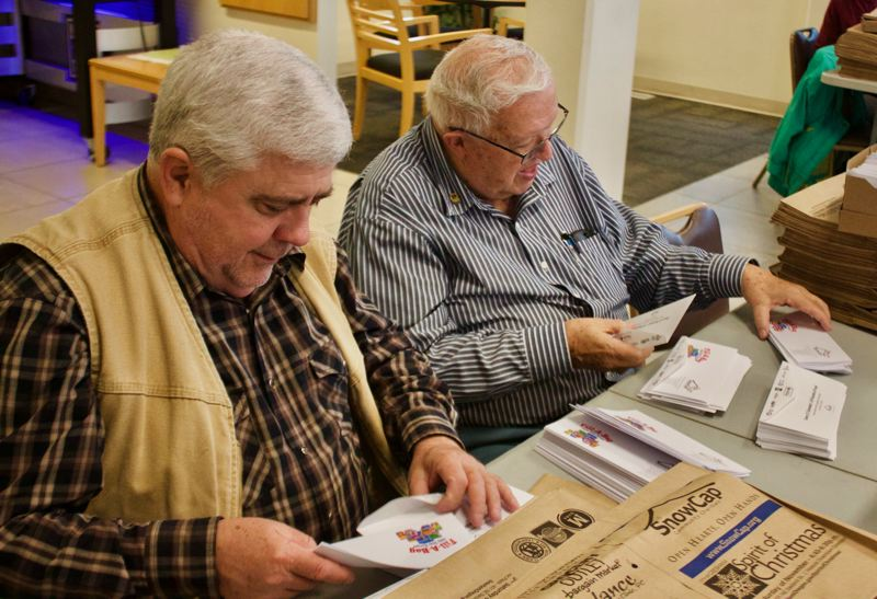 FILE PHOTO - Volunteers prepare bags for the Tuesday, Nov. 14 edition of The Outlook.