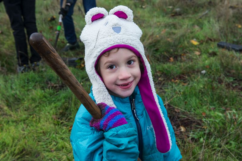 CONTRIBUTED PHOTO: PORT OF PORTLAND  - A young volunteer holds a shovel at the natural area near Troutdale most locals call Thousand Acres.