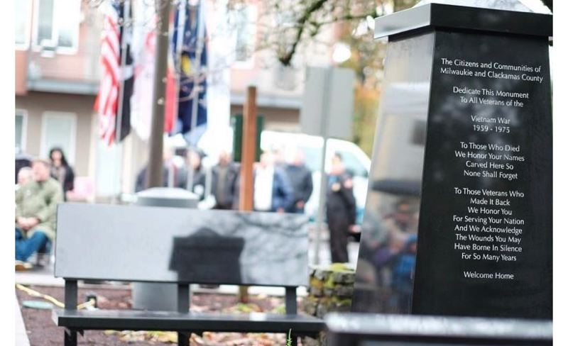 PHOTO BY: HAMID SHIBATA BENNETT - Two black-granite benches provide a place for quiet reflection next to a black-granite obelisk featuring 44 names of Clackamas County veterans who died in Vietnam.